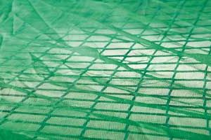Safety net with debris overlay